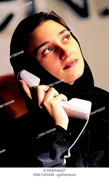 Arab businesswoman speaking on the telephone