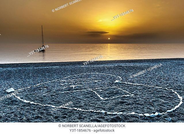 Europe, France, Corse, Haute Corse 2B, Cap Corse. Nonza. Drawing heart shape on the black pebble beach