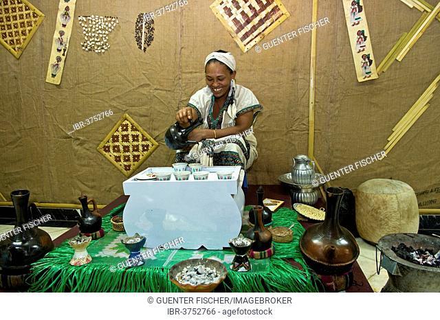 Ethiopian woman pours coffee in a traditional coffee ceremony, Addis Ababa, Oromia Region, Ethiopia
