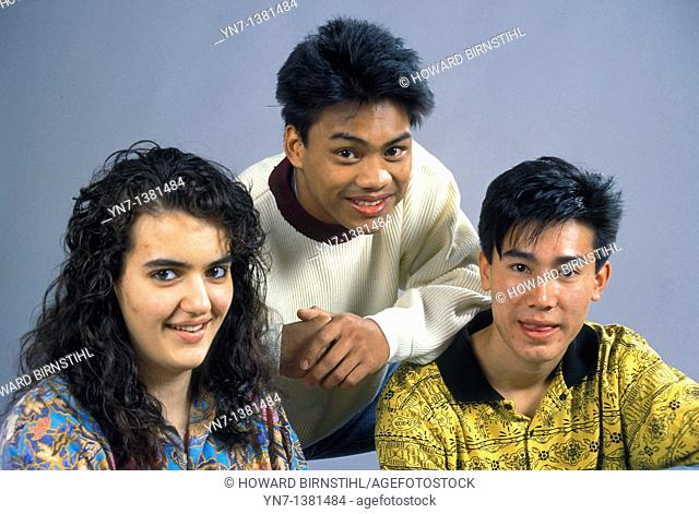 close up studio portrait of three happy teenagers from varying ethnic backgounds