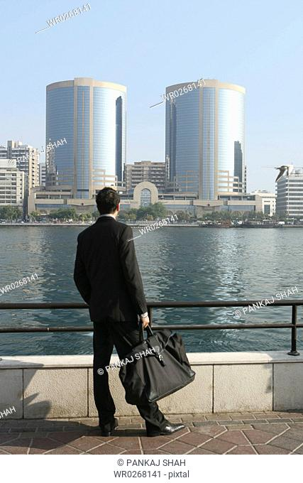 A Businessman looking at the building seen during at day