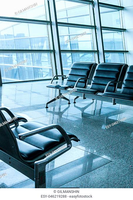 empty airport terminal waiting area with chairs