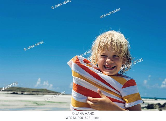 France, Brittany, happy boy on the beach