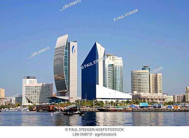 Boats in front of National Bank of Dubai and Dubai Chamber of Commerce & Industry at Dubai creek. Dubai city. UAE