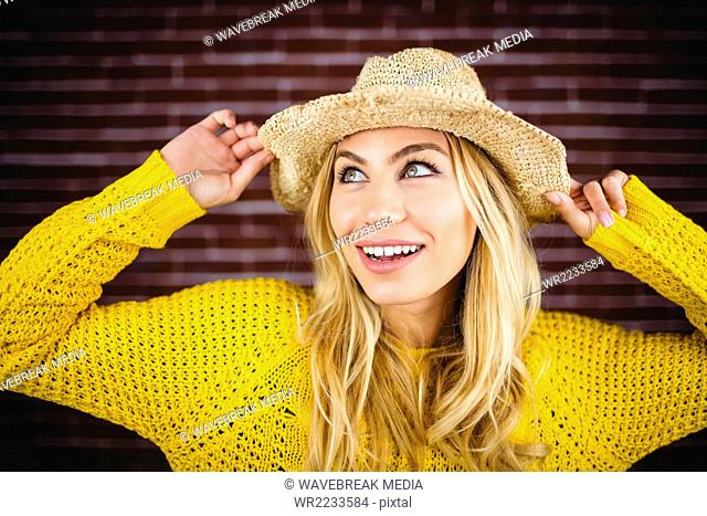 Portrait of blonde woman with straw hat