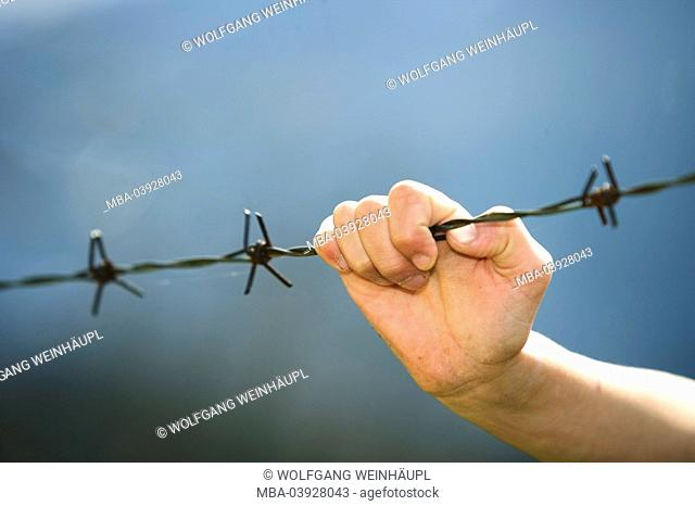 Barbed wire, hand, wire, holds on fence, barbed wire-fence Eingrenzung enclosure people child, child-hand, symbol, loneliness, isolation, Ausgrenzung, outsiders