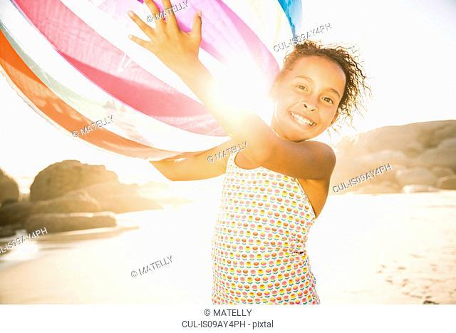 Girl with ball on beach