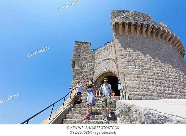 Dubrovnik, Dubrovnik-Neretva County, Croatia. Visitors on the steps of the Minceta tower. The old city of Dubrovnik is a UNESCO World Heritage Site