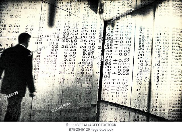 Digital photo montage of an executive walking through a maze of a Stock Market numbers