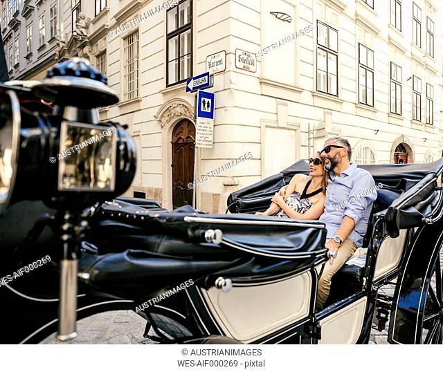 Austria, Vienna, couple in love on sightseeing tour in a fiaker