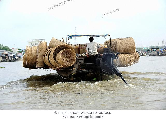 Asia,South East Asia,Vietnam,boat transporting wicker basket on the mekong river