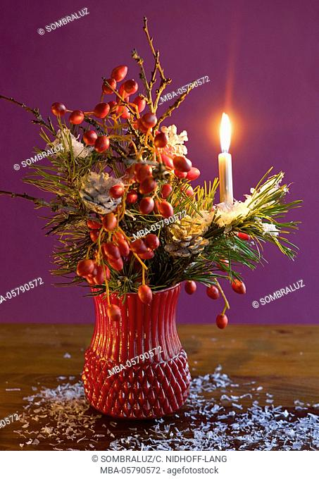 Christmas bouquet with candle and snow