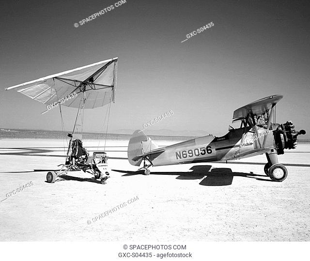 The Paresev 1-A Paraglider Research Vehicle and the tow airplane, 450-hp Stearman sport Biplane, sitting on Rogers dry lakebed, Edwards, California