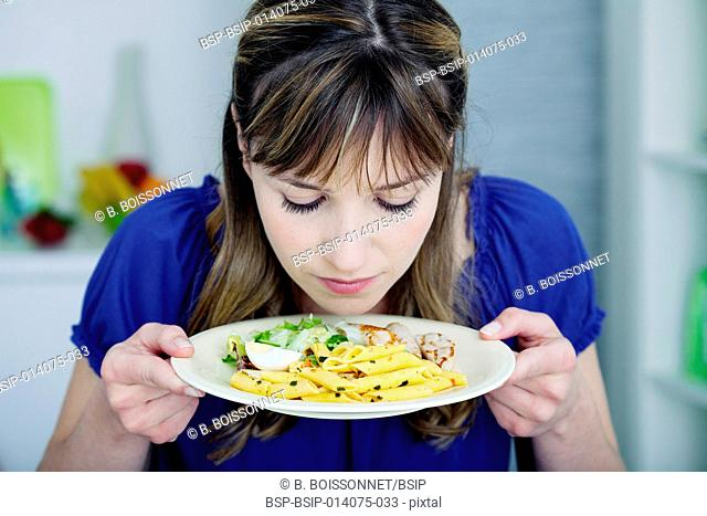 Woman smelling her meal
