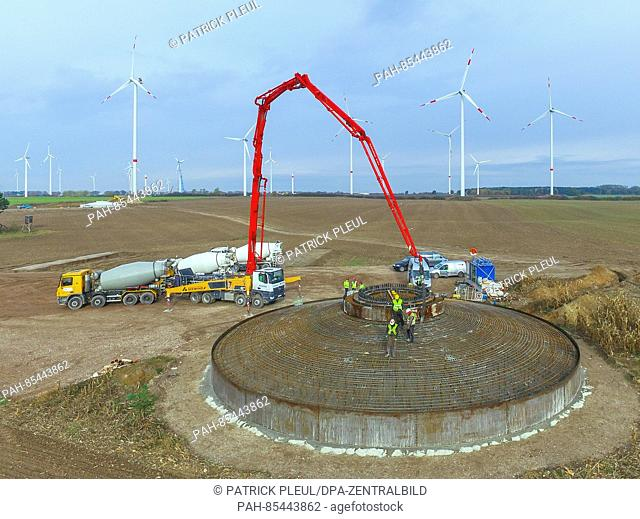 Workers cast the foundation of a wind energy facility near Jacobsdorf, Germany, 4 November 2016. About 700 cubic meters of concrete are used for the foundation