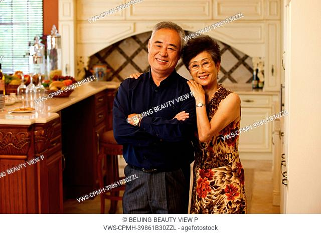 Old couple in luxury kitchen