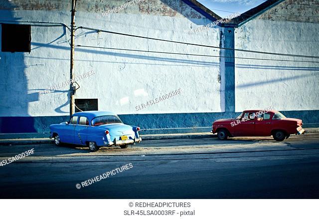 Vintage cars parked on city street