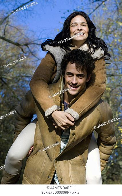 Woman on man's back
