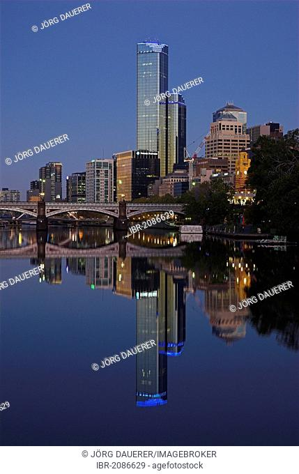 Skyline of Melbourne reflected in the Yarra River at dawn, Melbourne, Victoria, Australia