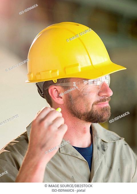 Engineer wearing earplugs on site