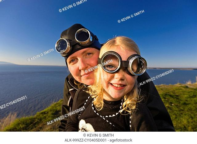 Mother and daughter wearing goggles and riding a vintage Vespa, Pt. Woronzof, Cook Inlet, Anchorage, Southcentral Alaska, Summer