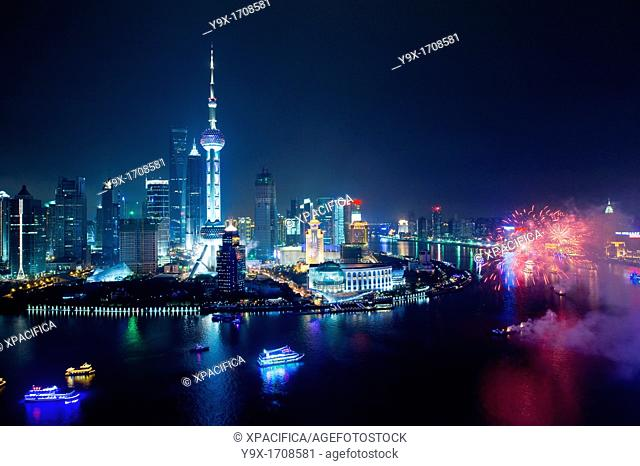 Fireworks going off over the Huangpu River in celebration of China's National Day, with the Pudong Skyline in the background