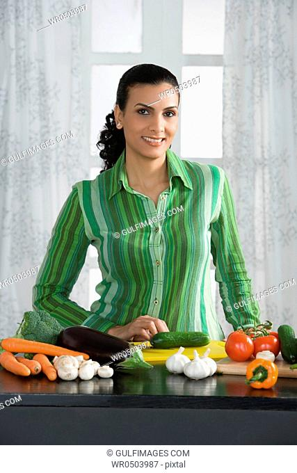 Woman preparing vegetables in the kitchen