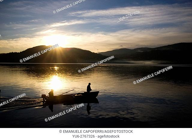 Fishermen come out to cast their nets, Ranco, Lake Maggiore, Italy