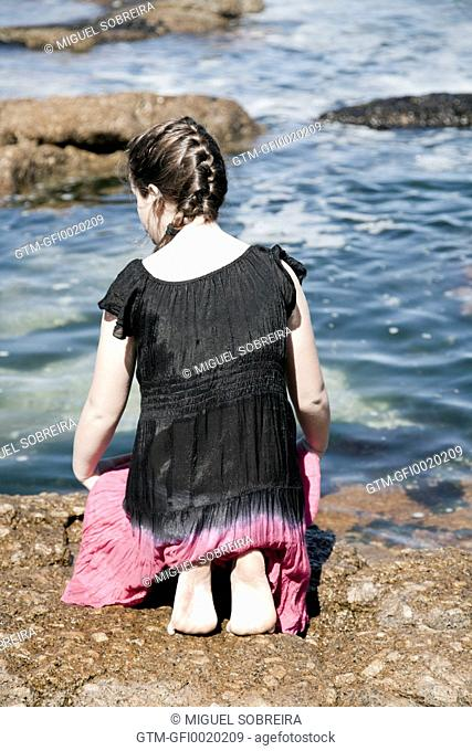Girl With Plait at Seaside