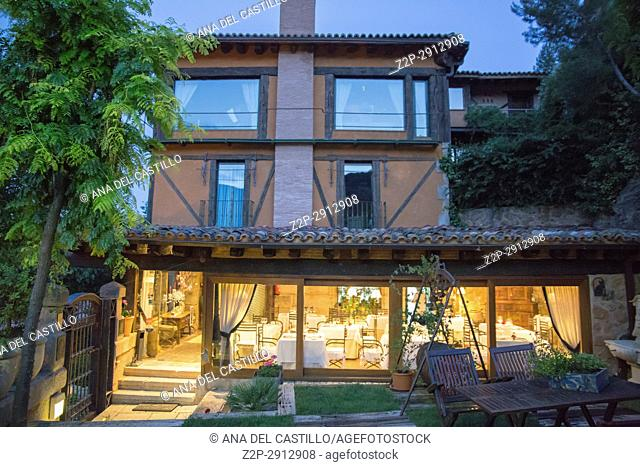 La posada de Santa Quiteria is a luxurious and rustic hotel in Somaen Soria province Spain on June 12, 2017 Garden and dinning room at twilight