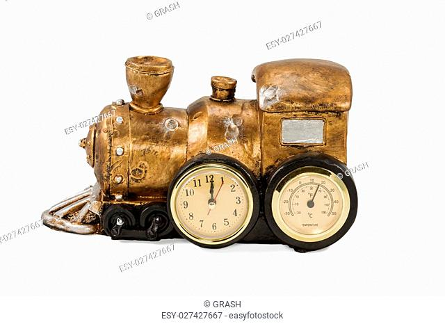 Clock with thermometer in the form of a vintage steam locomotive isolated on a white background