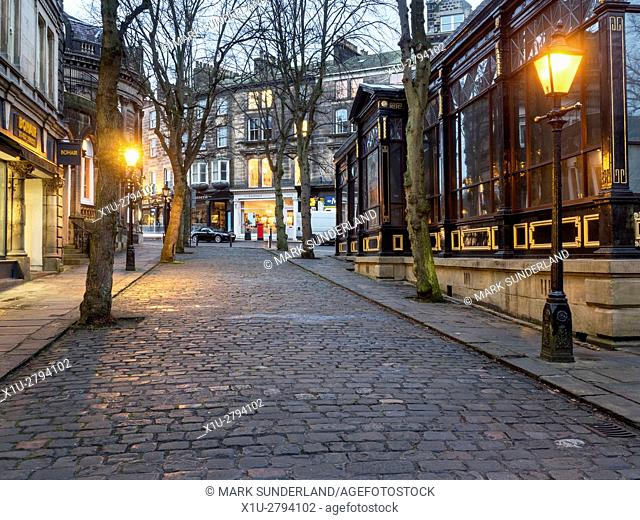 Crown Place Cobbled Street and Royal Pump Room Museum at Dusk Harrogate North Yorkshire England