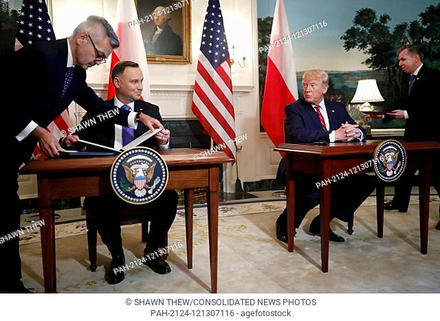 US President Donald J. Trump (R) and Polish President Andrzej Duda (L) participate in a signing ceremony in the Diplomatic Reception Room of the White House in...