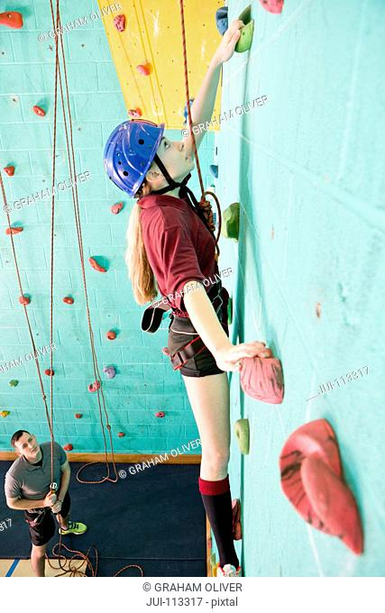 Girl climbing rock climbing wall