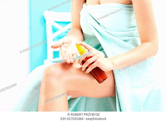 body oil. skin care. woman after bath rub skin with oil to the body