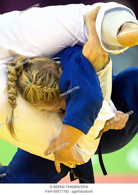 Germany's Luise Malzahn (blue) competes in the Women's -78kg Final with Marhinde Verkehr of the Netherlands at the Baku 2015 European Games in the Heydar Aliyev...