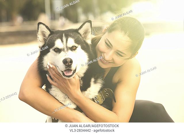 Cheerful woman embracing a dog