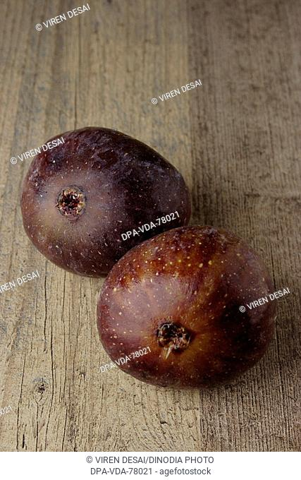 Two pieces of fruit figs