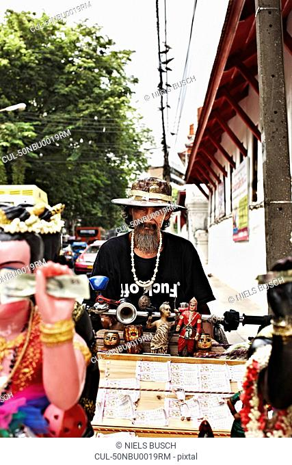 Street vendor with wares for sale