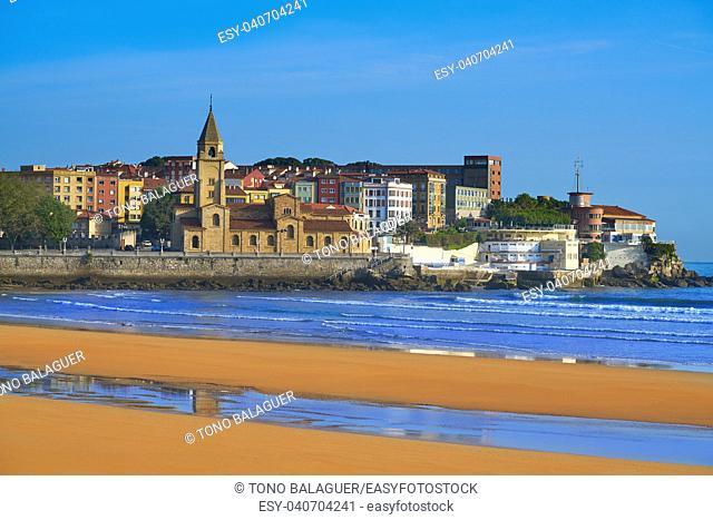 Gijon beach San Lorenzo and San Pedro church in Asturias Spain