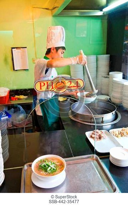 Chef preparing pho noodles in the kitchen, Pho 24 Restaurant, Hanoi, Vietnam