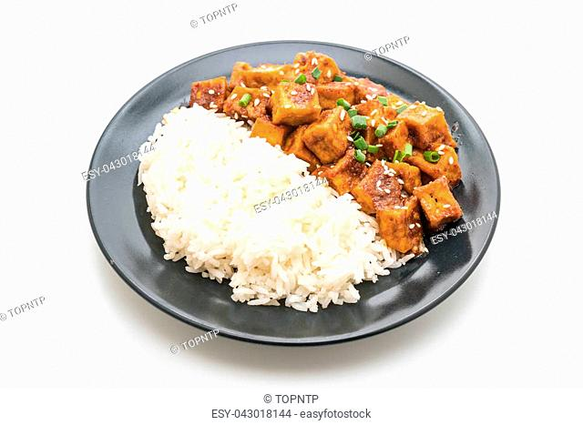stir fried tofu with spicy sauce on rice isolated on white background