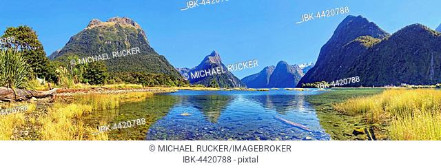 Panorama of Milford Sound, Mitre Peak reflected in water, Fiordland National Park, Te Anau, South Island, New Zealand