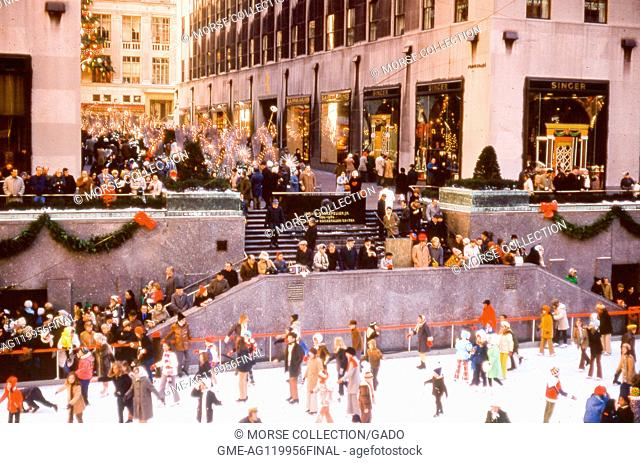 View of the Rockefeller Center ice rink filled with visitors skating during the Christmas season, in Rockefeller Plaza, midtown Manhattan, New York City