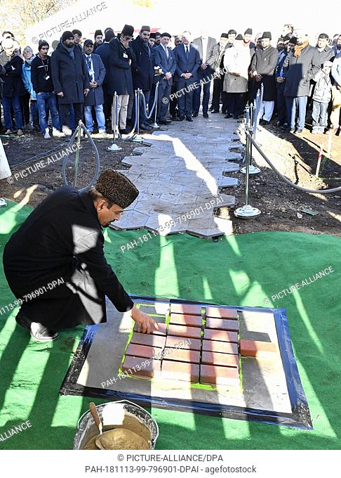13 November 2018, Thuringia, Erfurt: Community members lay the foundation stone for a new mosque. The Ahmadiyya community with about 100 members wants to build...