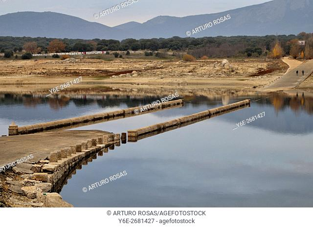 In summer, time of drought, the drop of level of the water in Valmayor Reservoir puts to discovered the old bridge of El Tercio (XVIII century)