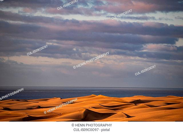 Scenic view of Maspalomas sand dunes and dramatic sky, Gran Canary, canary Islands, Spain