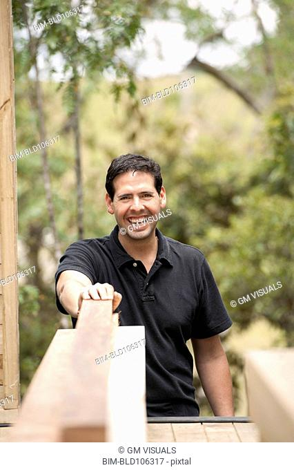 Smiling Hispanic carpenter
