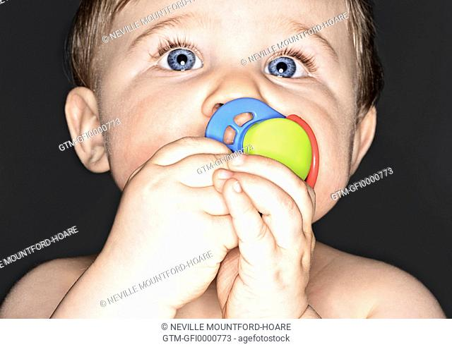 Close-up of baby sucking pacifier