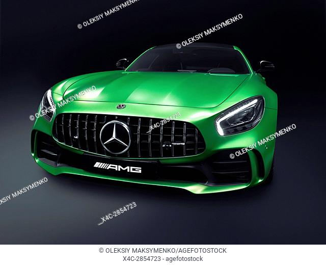 Green 2017 Mercedes-Benz AMG GT R Coupe sports car Grand Tourer luxury car isolated on black background with clipping path